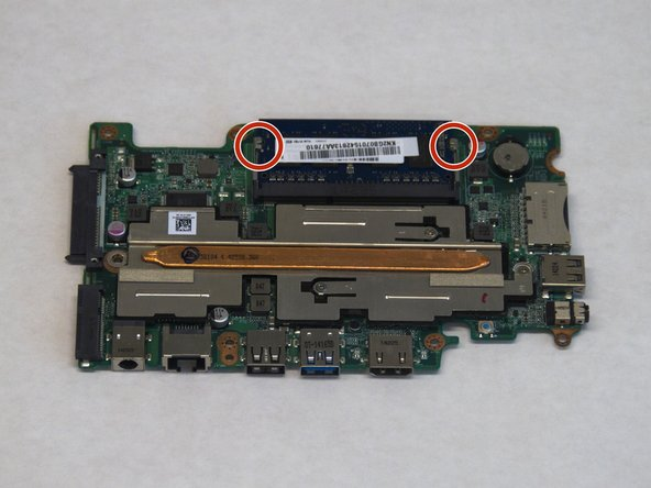 Flip over the motherboard after removing it from the case.