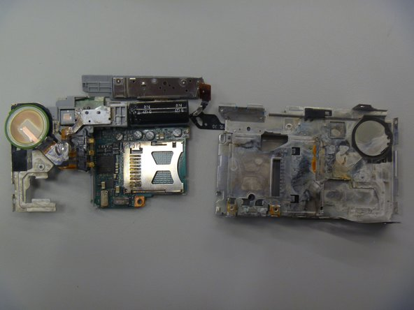 Flip motherboard parts to position shown.