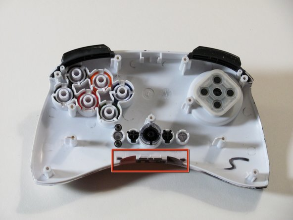 Image 3/3: When reassembling the controller, make sure that the bottom plastic piece is fully inserted into its slot before replacing the circuit board.