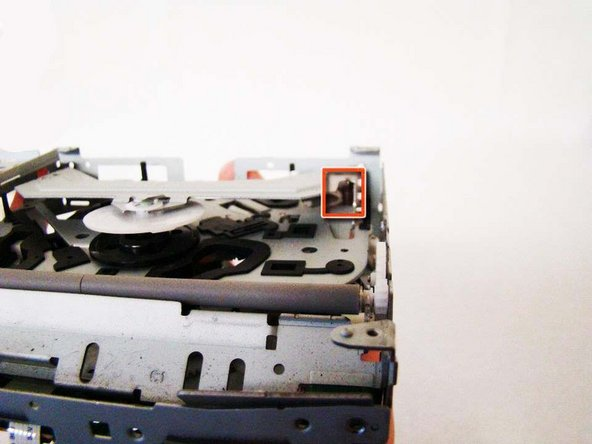 Pay extra attention to the spring inside the CD-Drive.  This will be crucial for the next step.