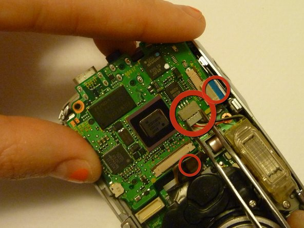 Make sure to use small force so the wiring is not damaged.  It may help to gently wiggle the tape.