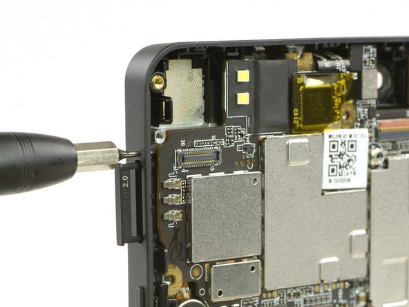 Use a SIM card eject tool, to eject the micro SD card slot on the other side.