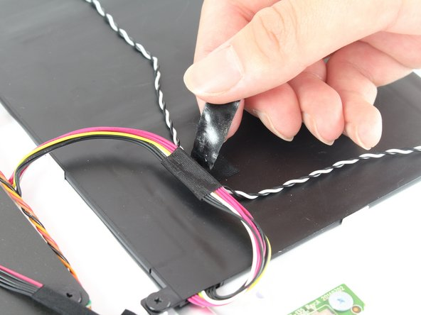 Remove the black tape holding down the two bundles of wire.