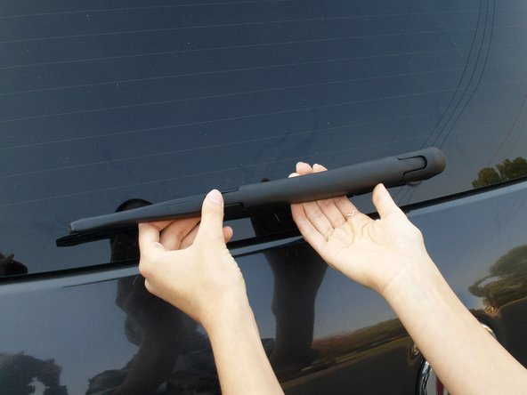 Gently rest the wiper against the windshield.