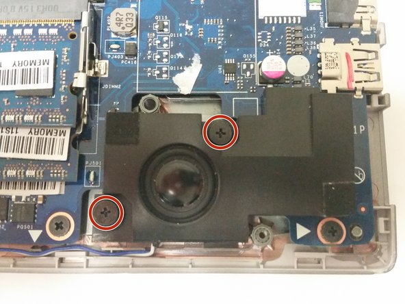 Remove the two 8mm Phillips #1 screws holding the right speaker in place.