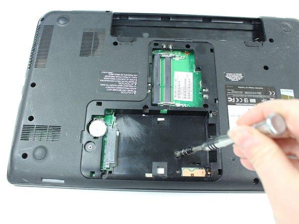 Using the JIS #000 screwdriver, remove the .5mm screw.