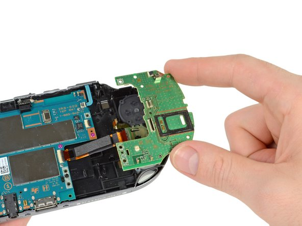 Image 1/2: The PS Vita control interfaces are separated into several small pieces, further enhancing repairability of this device.