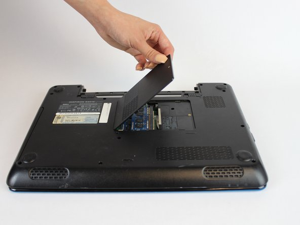 Once the RAM cover is free use your hand to pull from the side with the screw: UP and OUT to remove the RAM cover.