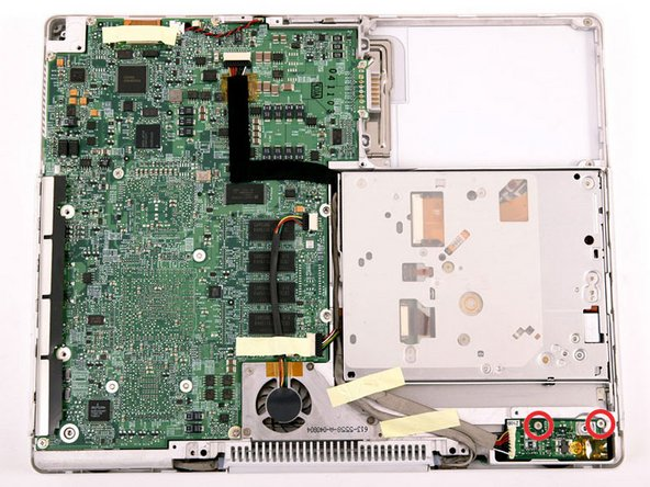 Image 1/1: Remove the two Phillips screws securing the DC-In board.