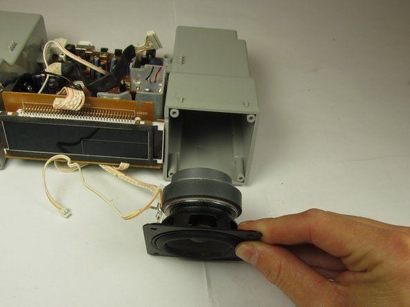 The right speaker is pictured; the same procedure is necessary to replace the left speaker.