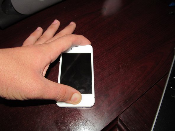 Try to reset the phone. Do this by holding the power and home buttons together for around 30 seconds.