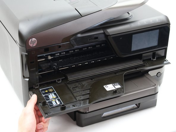 Open the front panel door by pulling forward on the slot located on the front-left side of the printer.
