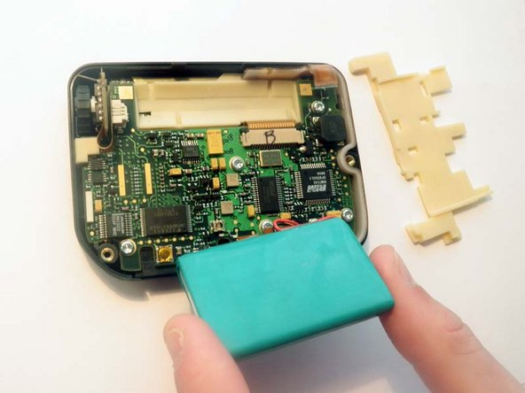 Remove the rubber placement pad that sits under the battery and set aside for later use. Gently fold back the battery, making sure the small plug connecting the battery to the logic board remains intact. Extra care should be taken as this part is quite delicate and easy to damage.