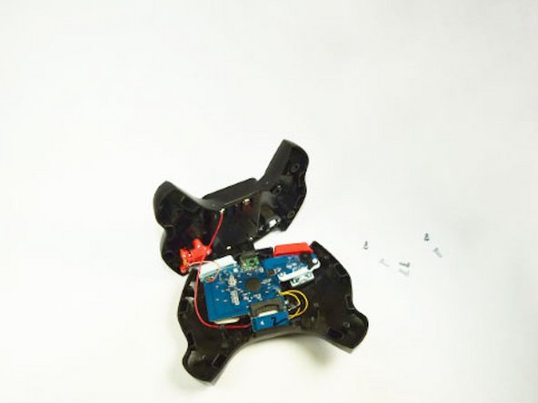 Pop the front of the controller casing from the back and carefully lay the controller out with circuits exposed.