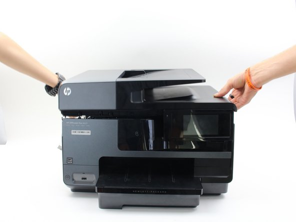 Remove the top of the printer by lifting it from both sides.