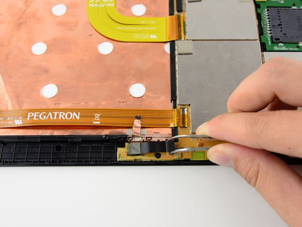 Carefully remove the ribbon cable from the housing by pulling gently upwards on the sides of the cable housing. The cable should come straight up off of its housing.
