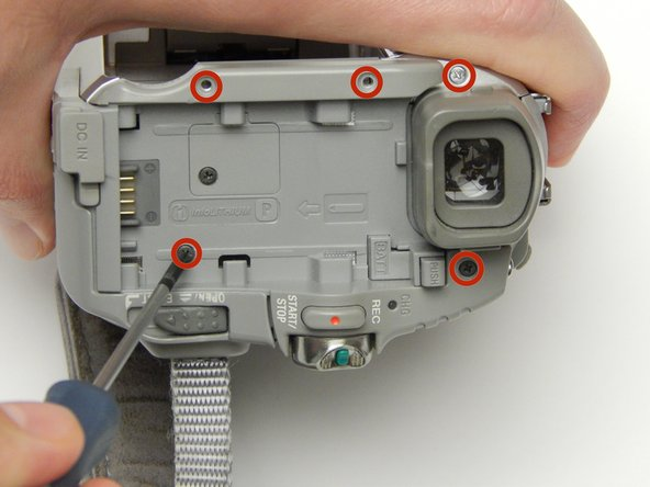 Image 2/3: Remove the five 5 MM Phillips #1 screws circled here.