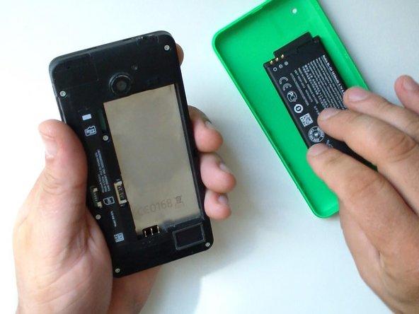 Image 2/3: Remove the black tape near to the loudspeaker.