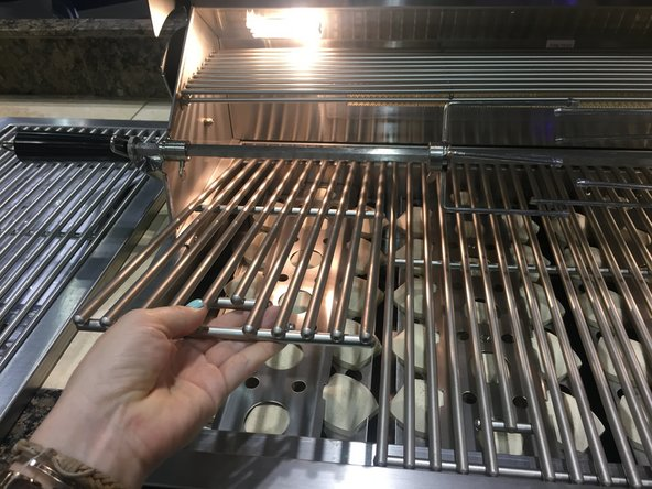 ... Carefully lift grill plate located above briquettes ... & Gas Grill Ceramic Briquettes Replacement - iFixit Repair Guide