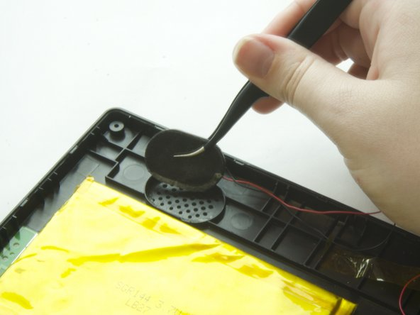 Use the tweezers to lift the speakers out of its compartment, including the felt cover attached to the plastic.