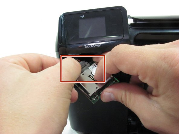 Pull the memory card reader's circuit board out of its slot.