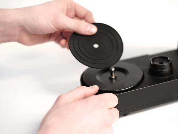 Remove the rubber pad by lifting it up.
