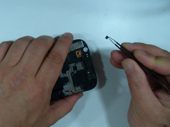 Remove the remnants of the adhesive sticker and clean the LCD.