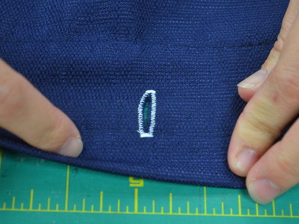 Be careful not to cut through the stitching, you only want to cut the fabric between the rows of stitching.