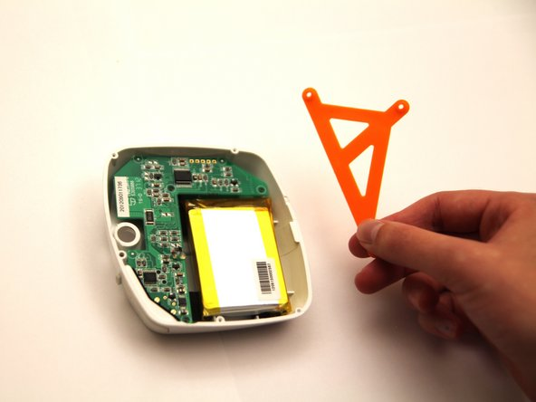 Simply lift up the orange battery cover and place it to the side.