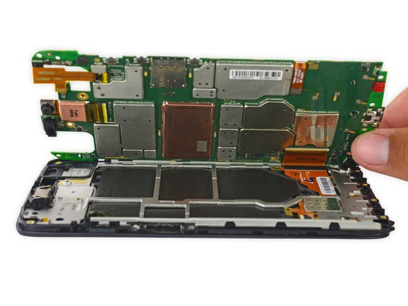 Carefully lift up the motherboard to expose the display connector.
