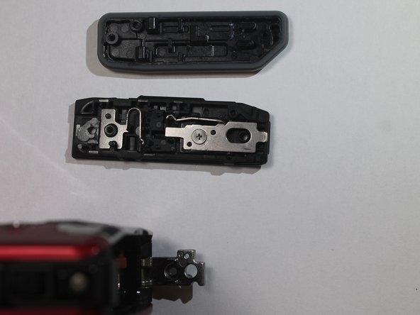 The entire battery compartment cover  will also detach from the camera.