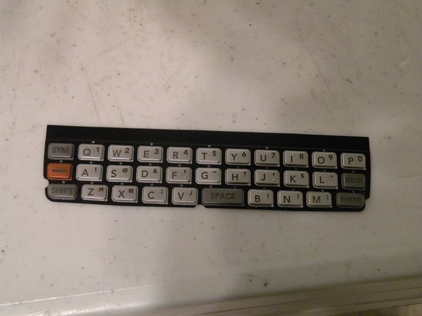 The keypad cover is easily replacable, and simply lifts out.