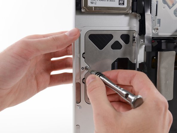 Image 2/2: Use the large tri-wing screw at the bottom of the trackpad to adjust the click stroke.