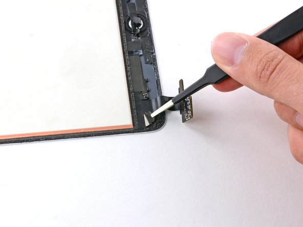 If necessary, use a pair of tweezers to partially peel back the piece of tape covering the smart cover magnet near the lower left corner of the front panel assembly.
