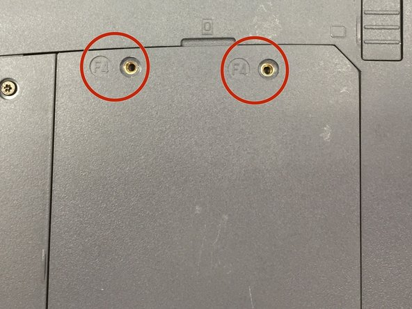 Remove two screws labeled F4 with precision screwdriver (Phillips size #00).