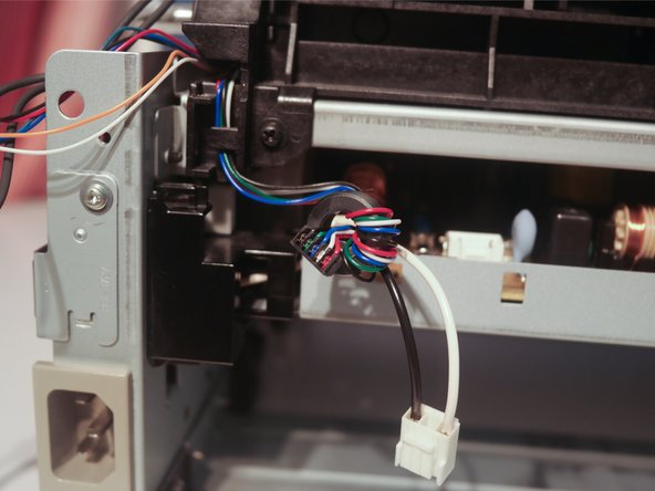 Disconnect the main motor cable.