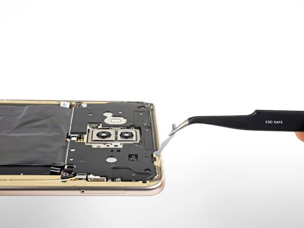 Before you install a replacement back cover, be sure to remove all traces of perimeter adhesive from the phone frame.