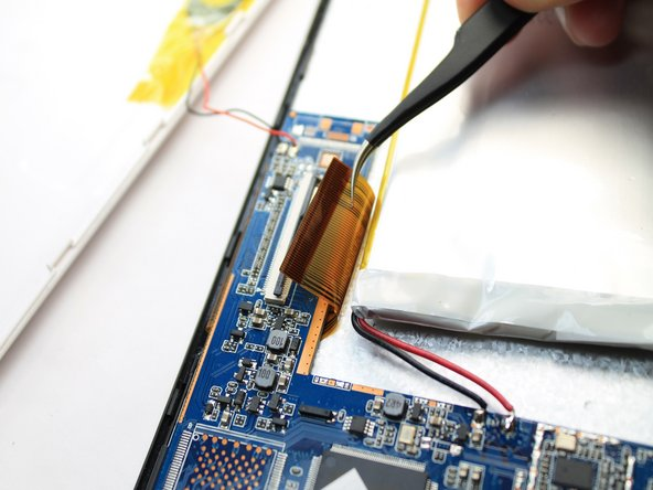 Image 3/3: Gently remove the ribbon cable from the socket using a tweezers.