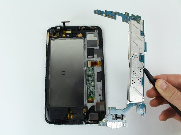 Once the motherboard is removed, your device should look like the device in the third picture.