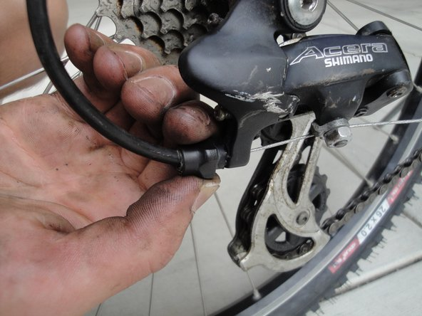 Fine tune the derailleur by tightening or loosening the barrel adjuster screw. Loosening this screw causes the derailleur to move slightly towards a larger sprocket, while tightening it moves the derailler towards a smaller sprocket.