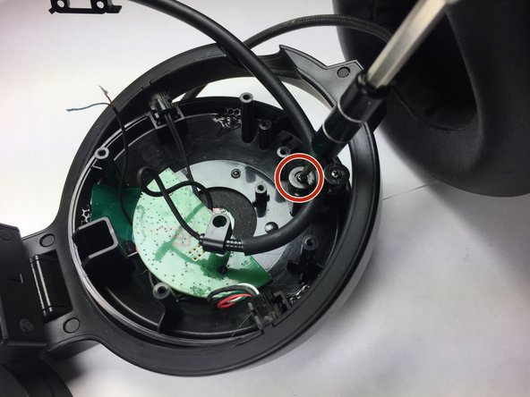 Image 3/3: While unscrewing the spinning-wheel apparatus, remove only one wheel to free the microphone cable.