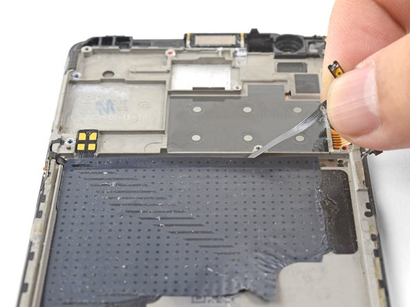 Lift the volume flex cable upwards from its position, removing it from its groove.