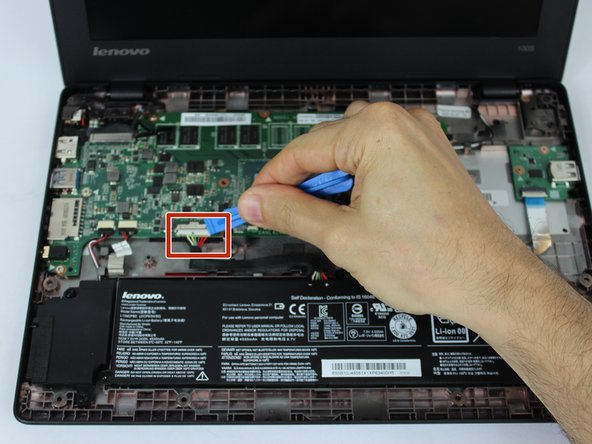 Locate the cable attaching the battery to the motherboard and gently unplug it by hand.