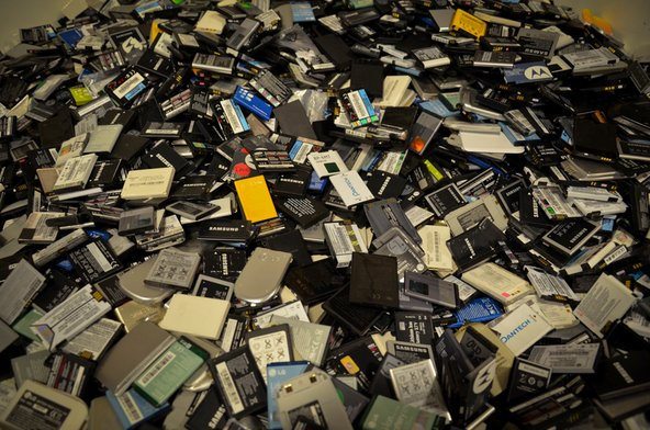 A pile of old cell phones at Recellular warehouse