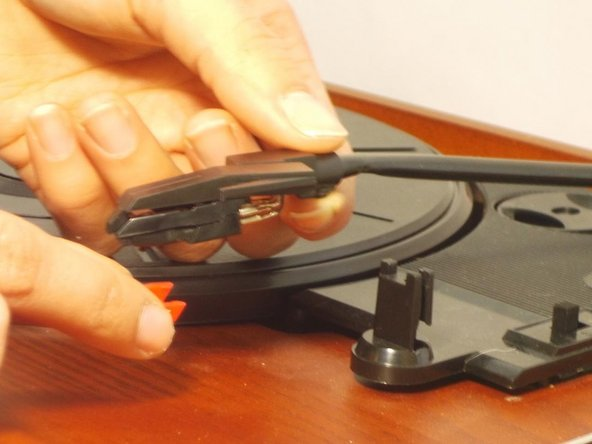 Image 1/1: Be careful not to touch the stylus tip when handling the tone arm. This is what plays your records.