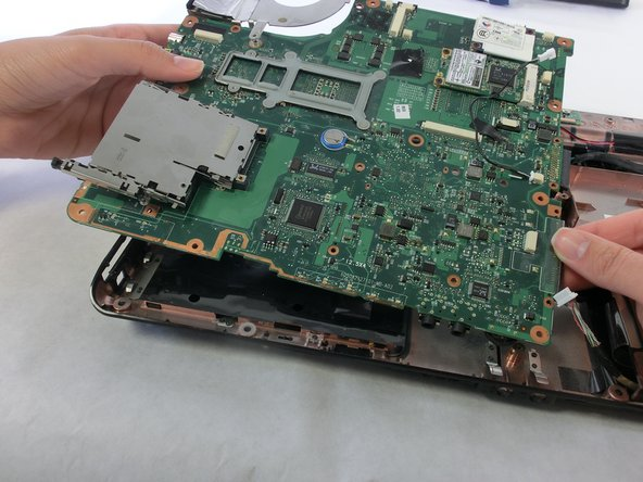 Do not force the motherboard out. If the motherboard breaks, it is not repairable. You will have to buy a new one.