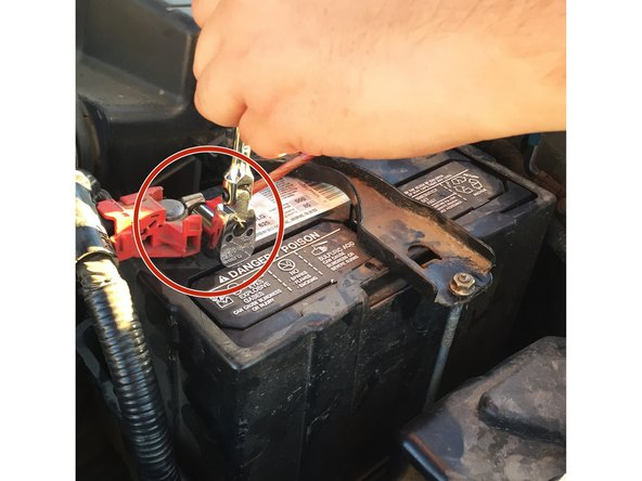Loosen and remove the positive (Red) cable from the terminal.