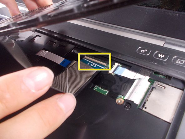 You will have to flip a small tab up where this thin wire goes into the insert, so the wire can be released and the keyboard can be removed.