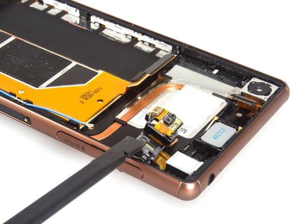 Image 1/3: Cut the adhesive sticker between headphone jack and midframe.