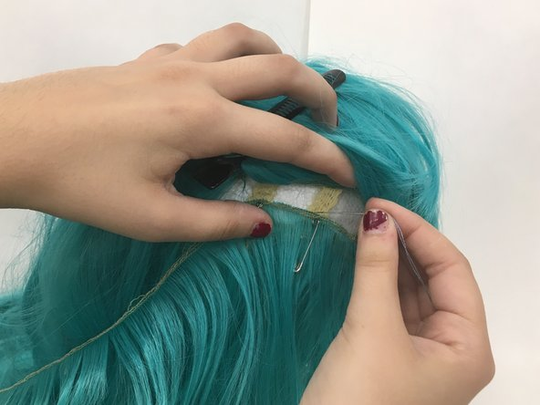 Sew the weft in at each of the non-elastic bands of the wig in the damaged area.